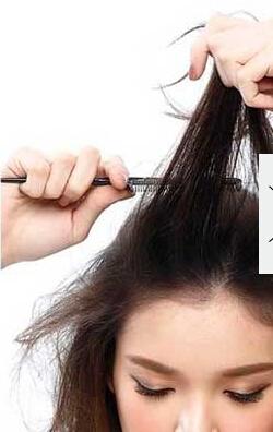 化妆学校分享 个性时尚的蓬松盘发